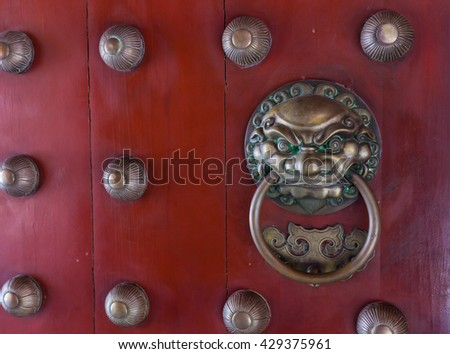 The door knob on the gate of Buddha tooth relic temple, Singapore.  - stock photo