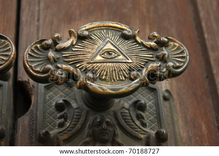 The Door knob to Storkyrkan in Stockholm with the all seeing eye on it. - stock photo