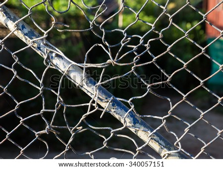 The door metal mesh wire fence, Some frayed Easily be tied - stock photo