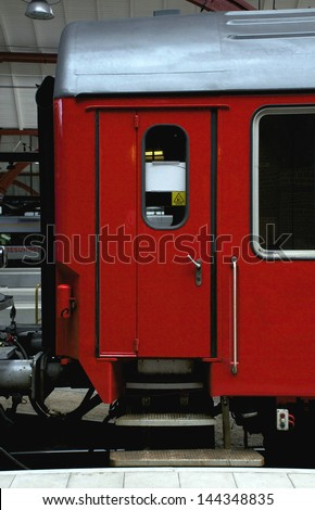 the door of a red railway carriage