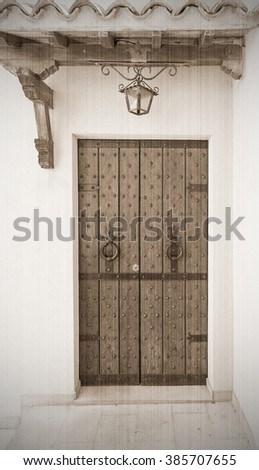 The door to the old-style province in Italy. Old style, sepia - stock photo