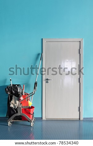 The door to the store room and trolley for cleaner - stock photo