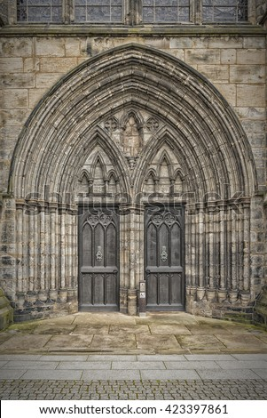 The doorway entrance of Glasgow Cathedral in Scotland. - stock photo