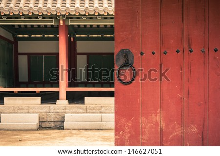 The doorway to a temple area in Asia. - stock photo