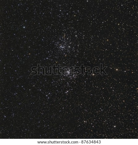 The Double Cluster, an open cluster in Perseus - stock photo