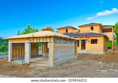 The double doors garage and the house ( home ) under construction. Vancouver, Canada. - stock photo