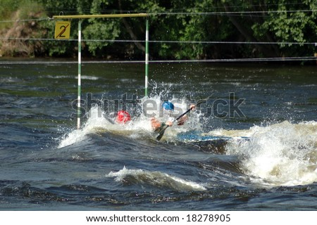 The double sports kayak passes gate at competitions on a rowing slalom - stock photo
