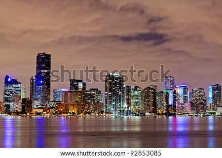 The downtown Miami bayfront at night, showing hotels, condos and office buildings.