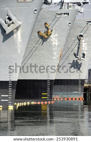 The draft or draught of a ship's hull is the vertical distance between the waterline and the bottom of the hull or keel. The weight of the cargo on board by calculating the total displacement of water - stock photo