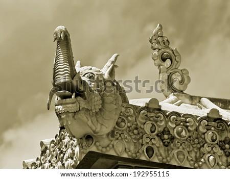 The dragon on the roof of the Tengboche Monastery -Ã?Â??Ã?Â?? Nepal, Himalayas (stylized retro) - stock photo