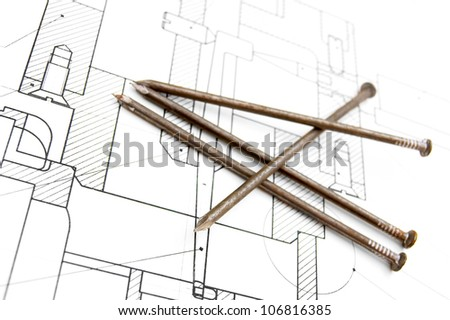 The drawing and nails . - stock photo