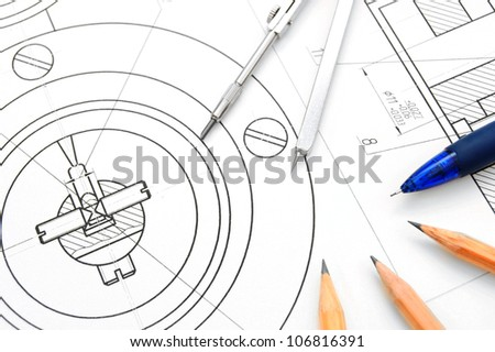 The drawing, pencils and compasses. - stock photo