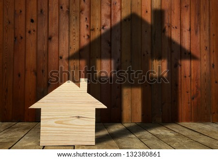 the dream to build his wooden house - stock photo