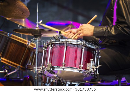The drummer in action. A photo close up process play on a musica - stock photo