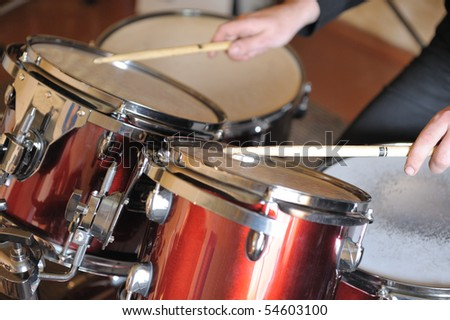 The drummer in action. A photo close up process play on a musical instrument - stock photo