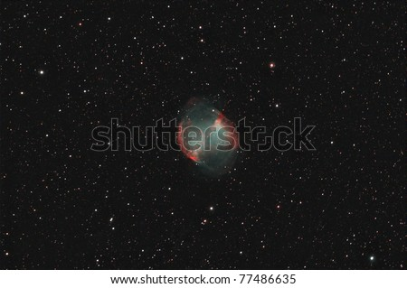 The Dumbbell Nebula Messier 27 (M27, NGC 6853) is perhaps the finest planetary nebula in the sky. - stock photo