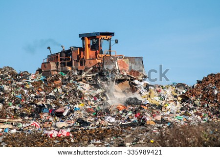 The dump and the bulldozer - stock photo