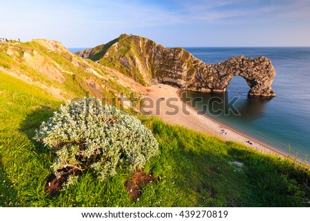 The Durdle Door rock arch on the Dorset Coast in Southern England, photographed from above. - stock photo