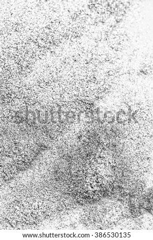 The dust of gray eye shadow on a white background - stock photo