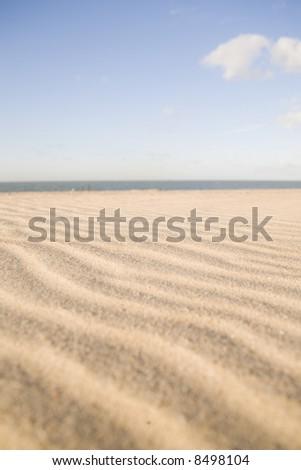 the dutch beach on a sunny summer day with blue sky - stock photo