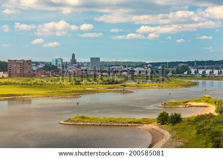 The Dutch city of Arnhem in Gelderland with the Nederrijn in front - stock photo