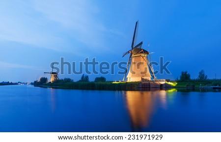 The Dutch Windmills at Kinderdijk, The Netherlands, an UNESCO World Heritage Site. - stock photo