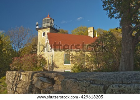 The Eagle Bluff Lighthouse overlooks the waters of Green Bay in Lake Michigan.  Today the lighthouse is located in Peninsula State Park, Door County, Wisconsin - stock photo