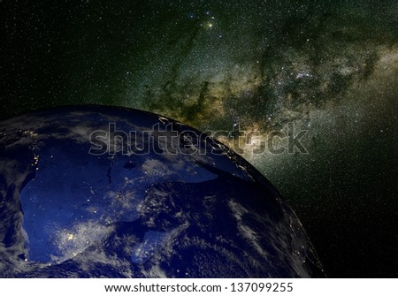 The Earth from space at night and the Milky Way. Elements of this image furnished by NASA. Other orientations available.