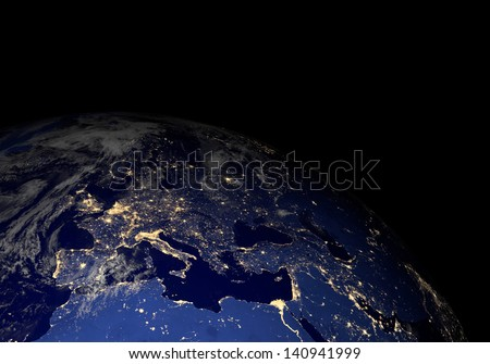 The Earth from space at night. Elements of this image furnished by NASA. Other orientations available. - stock photo