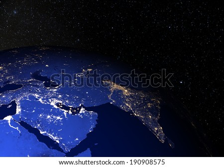 The Earth from space at night, with stars in the background. Middle East. Elements of this image furnished by NASA. Other orientations available.  - stock photo