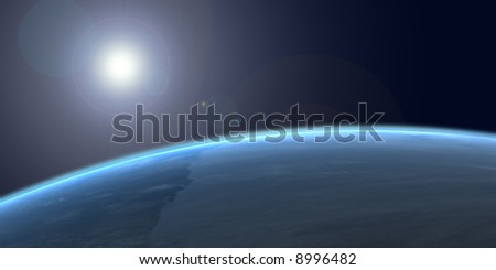 The earth from space with the sun reflected off the planet surface