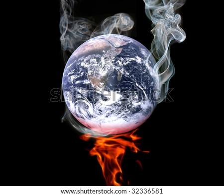 The Earth over a flame, smoking. - stock photo