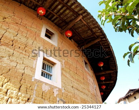 The Earth Tower of Hakka -an ancient Chinese house call Hujian Tulou in China . It was in  list of world heritage by UNESCO. The house built for guarding  against external aggression in ancient.   - stock photo