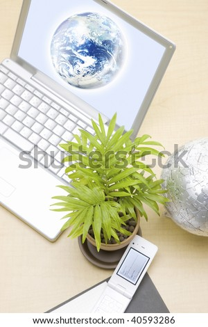 The earth which suits a screen of a PC and plant.