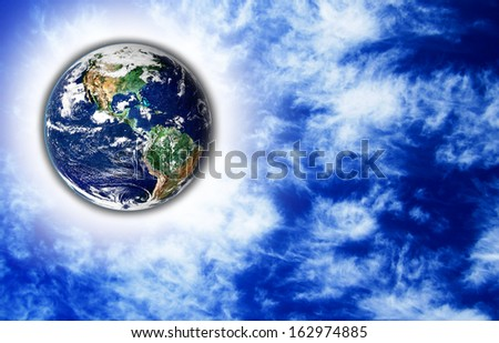 The Earth with light beam and sky in background,Elements of this image are furnished by NASA  - stock photo