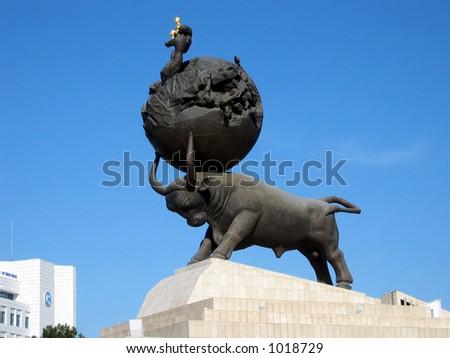 The earthquake monument - Ashghabat (Turkmenistan) President Niyazov on top of the World - stock photo