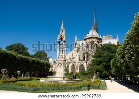 The east end of Notre Dame de Paris showing the flying buttresses and various other Gothic architectural elements.It is a European architectural history landmark sign. - stock photo