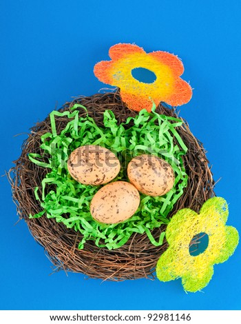 The easter eggs in nest and flowers.