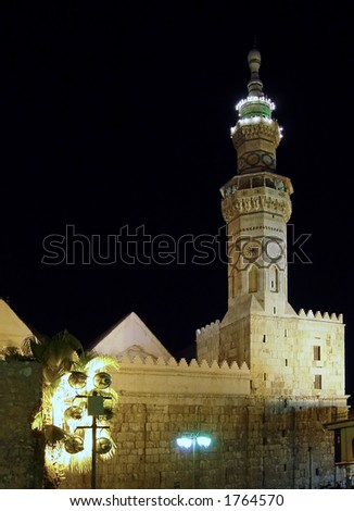 The Eastern Minaret of the Omayyad Mosque by night. Damascus, Syria. - stock photo