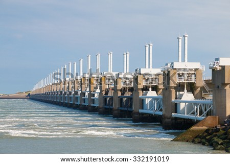 The Eastern Scheldt storm surge barrier or Oosterscheldekering in Zeeland, Netherlands. This largest Delta Work of a series of dams designed to protect the Netherlands from flooding from the North Sea - stock photo
