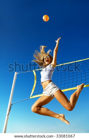 The ecstatic young girl in high flying with a ball - stock photo