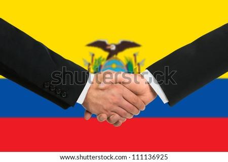 The Ecuador flag and business handshake - stock photo