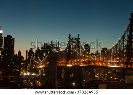 The Ed Koch Queensboro Bridge a cantilever bridge over the East River at twilight in New York City, USA. - stock photo