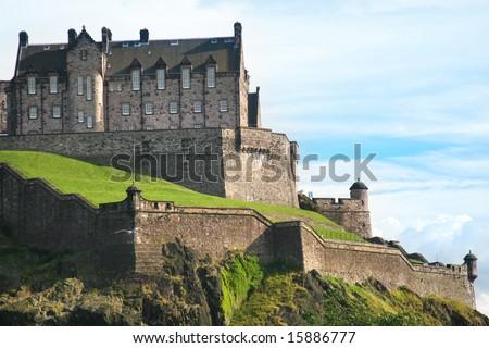 the Edinburgh Castle lit by evening sun - stock photo