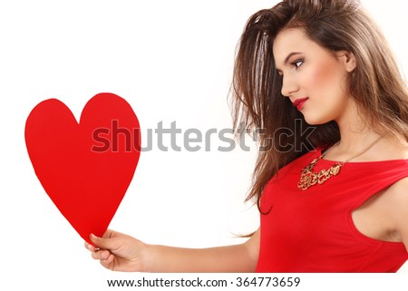 the effective young woman in a red dress with red heart Valentine's Day card in hands. white background - stock photo