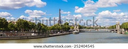 The Eiffel Tower and Pont Alexandre III in Paris, France - stock photo