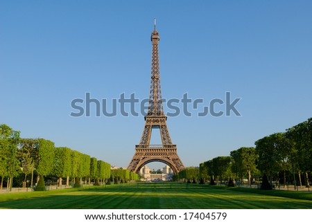 The Eiffel Tower from the Champ de Mars at sunrise. - stock photo