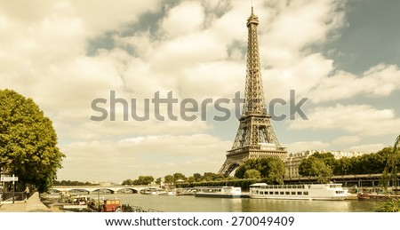The Eiffel tower from the river Seine in Paris - stock photo