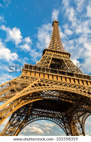 The Eiffel Tower in Paris, France in a beautiful summer day - stock photo