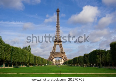 The Eiffel Tower in the morning with some clouds in the sky. Summer time